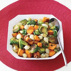 YUM YUM YUM! I want this so bad! Roasted Sweet Potatoes, Onions and Brussels Sprouts | MyRecipes.com