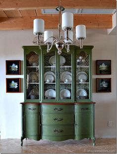 China cabinet painted with MMSMP in Boxwood mixed with bonding agent. Inside of hutch is accented with fabric applied using Mod Podge.