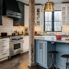 Bay Cabinetry - kitchens - off white subway tile, off white subway tile with gray grout, angled kitchen island, blue kitchen island, off set. Rustic Kitchen, Kitchen Dining, Kitchen Decor, Kitchen Vent, Kitchen Black, Country Kitchen, Kitchen Ideas, Foyers, American Kitchen Design