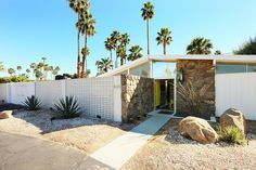 Beautiful William Krisel atomic ranch home in Twin Palms. Has the brick work I love, great roof line, and pops of color. Photographed by Chimay Bleue.