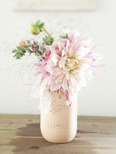 Light pink mason jar with spring floral arrangement.