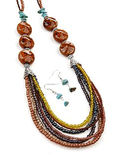 Multi Beaded Fashion Jewelry           Multi color beaded necklace with ceramic/turquoise bead accents and matching earrings. I love beads and often layer them. This link offers an interest array of apparel. http://www.thelittlebazaar.com/item/1465/