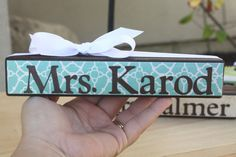cute gift idea made from a wooden block... paint it, modge podge scrapbook paper onto it, and use a cricut or vinyl for the lettering... cheap and easy