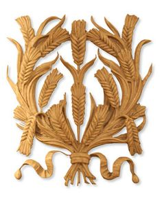 Stylised carving in wood of wheat ears.