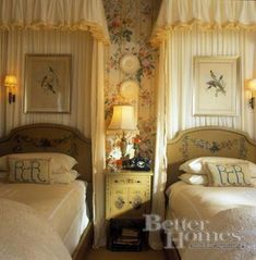 love the botanicals overlaying the bed curtains; details!