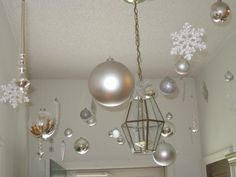 winter wonderland party hanging from ceiling  | Hang white & silver ornaments from the ceiling to ... | Christmas ide ...