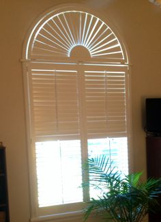 Sunburst arch plantation shutters. Available at Budget Blinds of Clermont