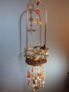 luck dragonfly hanging basket pretty intricate by MagpieDoodads
