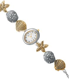 "7"" + 1"" extension gold tone and silver tone base metal fashion toggle watch The mother-of-pearl face measures 22mm x 26mm The links are starfish sand dollar and clam shell design"