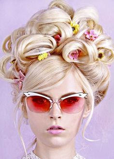 Floral updo + pink sunnies? Count us in.
