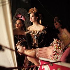 """This weekend, #NYMag brings you an exclusive behind-the-scenes portfolio of images shot backstage at @nycballet's performances of George Balanchine's The Nutcracker™ by corps de ballet dancer Devin Alberda. Here, characters from Act II's Land of the Sweets watch from the wings as Lauren Lovette performs her first Sugarplum variation of the season. Devin: """"Lauren's Sugarplum is gracious and plush; her joy is palpable and her sensuous line thrills."""" : @dalberda"""