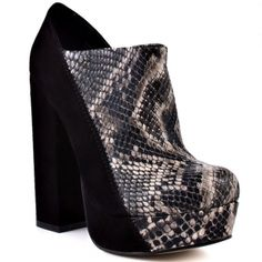 You'll wow them in this ankle boot from ZiGi. Duplex combines a snake print and black suede upper covering the 5 inch block heel and 1 inch hidden platform. This style has a wide opening making it easy to slip on. Bootie Boots, Shoe Boots, Shoes Heels, Black Suede, Black Leather, Girls Heels, Womens High Heels, Heeled Mules, Women's Stilettos