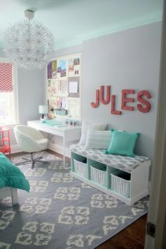 Light grey walls with pale Teal ceiling. Pops of more vibrant color.