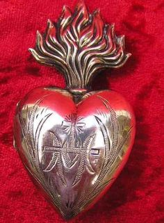 "AUTHENTIC 1800s SILVER GILT FLAMING HEART EX VOTO LOCKET RELIQUARY Authentic silver gilt flaming heart ex voto locket reliquary.  These reliquaries were used to house devotional messages of thanks and placed on a Saint in a church or place of worship.  Perfect size to be used as a pendant.  Measures: 2.54"" tall.  Has an ""O"" ring on the back to hang.  Excellent condition."