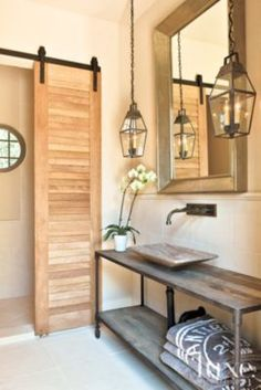 A poolside bathroom provides storage, while a sliding louvered door offers privacy for the water closet and shower. The vessel sink—with a wall-mounted faucet from Rocky Mountain Hardware—is affixed to a Restoration Hardware console.