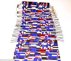 Chain reaction: Two slow moving textile 'displays' show the content and react to environmental changes such as heat and pressure by changing the colour and pattern of the fabric (pictured)