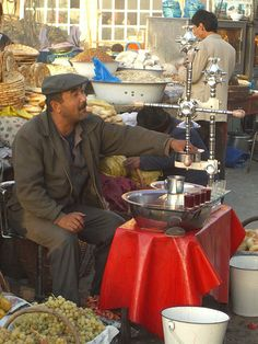 Pomegranate Juice Vendor - Kashgar, China by uncorneredmarket, via Flickr