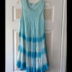 Blue sundress with embroidery and bead accents Beautiful aqua blues sleeveless dress. Embroidered at top and bottom edge of dress with bead accents.. 65% cotton 35% rayon. Dresses Midi
