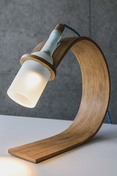 The Quercus lamp, by Max Ashford, is basically a bottle attached to a curved piece of wood - and it is this simplicity that makes it so spectacular. The materials used are fitting, the unclear glass, the cork and the blue wire. Max entered this lamp in the 'Delight in Light' competition, and you may vote for him here. All photographs by Lewis Gillingham.