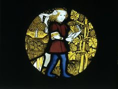 Roundel of clear and coloured glass with yellow (silver) stain and brown painted details. Depicting a young man cutting grapes off the vine and illustrating the month of September, from a series of the Labours of the Months. Made in England (Norwich), Medieval Stained Glass, Stained Glass Angel, Faux Stained Glass, Stained Glass Windows, Medieval Art, Renaissance Art, Medieval Pattern, Glasgow Museum, Black Pigment