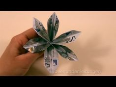 These step by step instructions help you to fold your own money origami flower. Money Origami, Origami Butterfly, Origami Flowers, Origami Paper, Diy Origami, Money Bouquet, Creative Money Gifts, Money Flowers, Graduation Cards