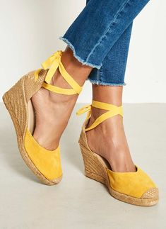 Let us introduce you to our spring collection. Web Exclusive - An alternative to a flat sandals are these lemon suede espadrille wedges, featuring a yellow lace up tie and natural back. Available in UK sizes 3-8. The heel height measures 9cm/3.5in.