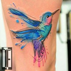 Hummingbird water color tattoo with crisp black outline, pink, blue, purple, yellow