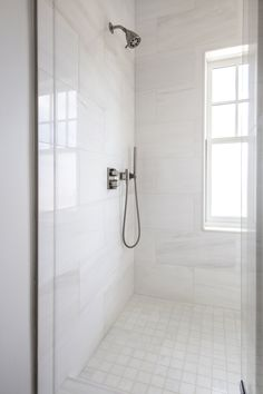 "The designers loved the Bianco Dolomiti Direto marble in a horizontal pattern because the tile ""becomes almost like a watercolor design with the natural marble veining. The lines of the ocean are reflected in the Dolomiti. Large White Tiles, Marble Bathroom, Marble Showers, Marble Shower Tile, Large Shower Tile, Large Tile Bathroom, Sophisticated Master Bath, Bathroom Inspiration, Small Bathroom Remodel"