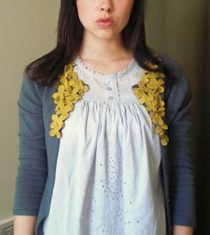 Adding flowers to a cardi- brilliant. pair this with the diy felt flowers and voila!