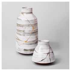 Enhance your space with the Short Stoneware Vase from Project 62™. The soft edges of its modern style and the gold detail running down the sides bring warm detail to any room you add it to. Place on your dining table and fill with your favorite flowers or let it be the focal point of  your coffee table decoration.<br><br>1962 was a big year. Modernist design hit its peak and moved into homes across the country. And in Minnesota, Target was born — with the revolu...