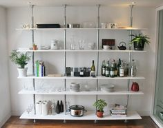 ***** Steel tension shelves are a good way to maximize storage space in small apartments. (I want this in the kitchen!)