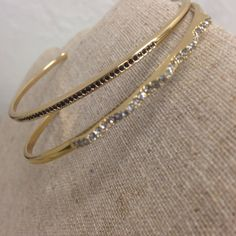 Stella & Dot Set of Two Layering Cuff Bracelets Set of Two Layering Cuff Bracelets - Set RV: $68 + Tax  Originally sold separately, these unique and delicate cuff bracelets are perfect for layering.  Diamante Cuff: Hand-set jet black micro pavé with shiny gold plating. RV: $34 + Tax  Pave` Chevron Cuff: Hand-set micro pavé sparkles both edgy and delicate. RV: $34 + Tax Both fit SM-LG wrists - adjustable  From a pet- free and smoke-free environment Stella & Dot Jewelry Bracelets