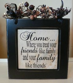 Home... where you treat your friends like family and your family like friends - Vinyl saying in black frame with berries on top
