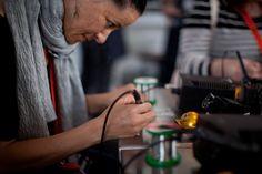 People learn to #solder during the #MAKE workshop inside GE Garages.