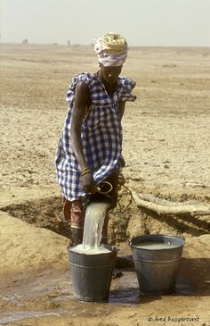 Mali, Sahel, Desert Landscape, Woman fetching Water.