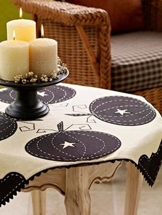 DIY~Make this handmade pumpkin tablecloth crafted from cotton and felted wool (or felt). Black pumpkin silhouettes on a creamy white tablecloth. This would be cute with an orange background too. I love the ric rac around the edges. Wouldn't this idea also make a fabulous table runner?