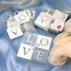 "$5.06-$7.00 LOVE Glass Coaster Set - It's easy to show some love with these glass LOVE coasters as stylish bridal shower favors and more. Declare your love with these playfully designed glass LOVE coasters! Lovely as bridal shower favors or for any occasion, your guests will adore these fun and functional home accessories. Each 3.5"" coaster is made of tempered glass for extra strength. These bri ..."