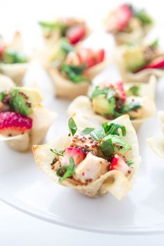 Chicken, Strawberry and Avocado Wonton Cups. A quick and simple appetizer—sweet strawberries, cool and creamy avocado and savory chicken are tossed together in a citrust-honey-mustard vinaigrette. Perfect for parties, baby and bridal showers or any springtime entertaining!