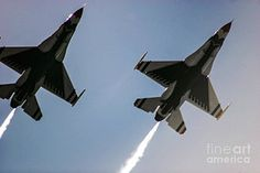 A very close up view of two jets flying in formation. Photo by Chandra Nyleen