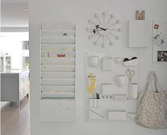 organized white office: Pretty white office wall with organization tools and a pretty bag!