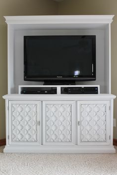 I turned an old, ugly china cabinet into an entertainment center.