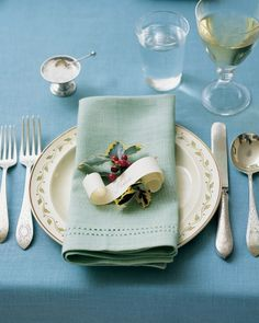 Set a Dickensian Table.  Love the paper scroll place card and holly with the pale green