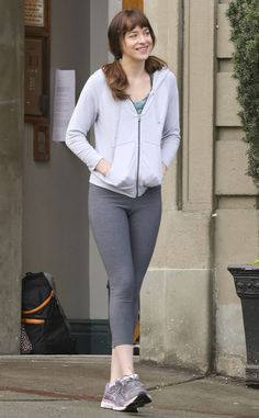 WORK IT OUT Dakota was seen on set sporting her workout gear for one of the film's running scenes.