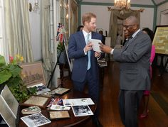 Prince Harry Photos Photos - Prince Harry with the Governor General Sir Rodney Williams as he attends attends a Charity showcase at Government House on the second day of an official visit to the Caribbean on November 21, 2016 in Antigua, Antigua and Barbuda. Prince Harry's visit to The Caribbean marks the 35th Anniversary of Independence in Antigua and Barbuda and the 50th Anniversary of Independence in Barbados and Guyana. - Prince Harry Visits The Caribbean - Day 2