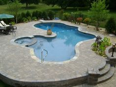 Are you dreaming of this Free Form Pool design in your backyard? #freeform #swimmingpool #pools #BarringtonPools