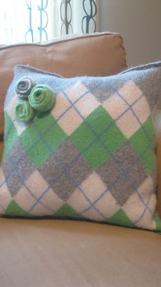 The old favorite ...pillows made from sweaters..upcycled...but she also has GOOD info on felting the old wool !
