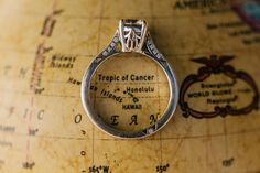 SUPER CUTE idea to have ring circle the honeymoon destination! LOVE