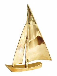 Decorative brass sailboat.  Falls into my dreams of sailing away.