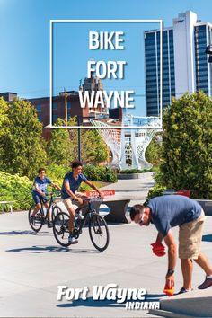 Two teens riding bikes through Promenade Park in downtown Fort Wayne, Indiana Fort Wayne Indiana, Riding Bikes, Teen, Outdoor Adventures, Park, Parks, Biking