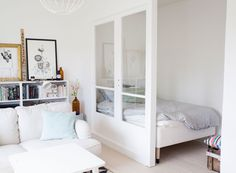 """The challenge: Create a """"bedroom"""" (well, at least a bed nook) in an open-layout studio apartment Tiny Studio Apartments, Studio Apartment Layout, Studio Layout, Plan Studio, Studio Apartment Divider, Studio Apartment Decorating, Studio Decor, Deco Studio, Studio Apt"""